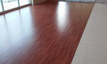 Photo: LONESEAL WOOD GRAIN VINYL flooring installed in CarMaxx show room