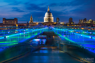 "Photo: Colored Lights on the Millennium Bridge, with St. Paul's - London, U.K.  The London Millennium Bridge is a pedestrian-only steel suspension bridge crossing the Thames and linking Bankside with the City. It is also referred as the ""Wobbly Bridge"" after an uncomfortable, swaying motion was noticeably felt on the first two days of the bridge's opening on June 2000. Attempts to modify the bridge to eliminate the vibrations were made and the bridge reopened in 2002. Other than being another architectural marvel on the Thames, the Millennium bridge is also known as the fictional Brockdale Bridge in the 2009 film Harry Potter and the Half-Blood Prince. The alignment of the bridge is also such that a clear view of St Paul's Cathedral is seen from across the river, framed by the bridge supports.  #MillenniumBridge   #StPauls   #London2012   #UK    #Olympics   #Travel   #Photography   © Yen Baet - www.YenBaet.com. All Rights Reserved. Join me on Facebook at www.facebook.com/YenBaetPhotography."