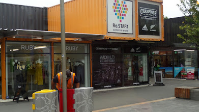 "Photo: This temporary shopping center was constructed of shipping containers!  The extremely popular ""All Black"" rugby team is the reigning champions of the world in nine player rugby."