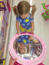 "Photo: Of course we had to check out the toys at Walmart. ""Mirror mirror on the wall, who is the cutest of them all?"""