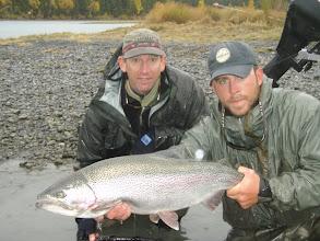 Photo: Joe Elmer a client of Alaska Drift Away fishing with a late fall Kenai river rainbow trout.