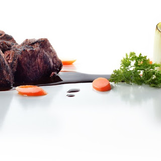Sous Vide Lamb With Caramelized Carrot Demi-Glace and Leek Marrow.
