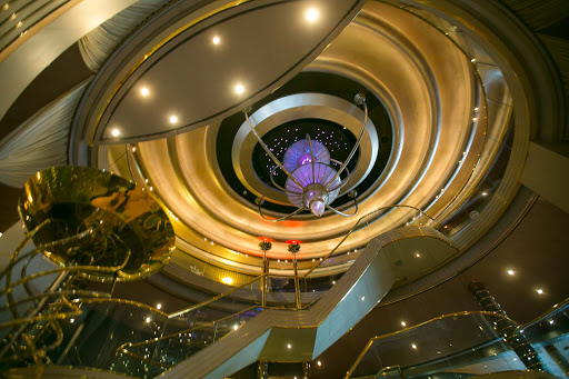 westerdam-atrium-horizontal.jpg - The stylish Waterford crystal sculpture atop the atrium in the heart of Holland America's Westerdam slowly rotates and changes color.