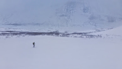 Photo: Wind-packed hard snow mixed with pockets of powder. Not fun to ski during low visibility.