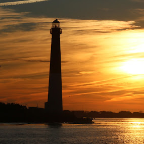 Sunset on ole' Barney by Rusty Jhorn - Landscapes Waterscapes ( water, red, bay, sunset, lighthouse, barnegat, inlet,  )