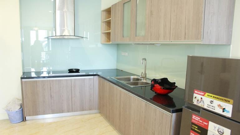 The kitchen - Nice and brand – new 2 bedroom apartment in Doi Can street, Ba Dinh district for rent
