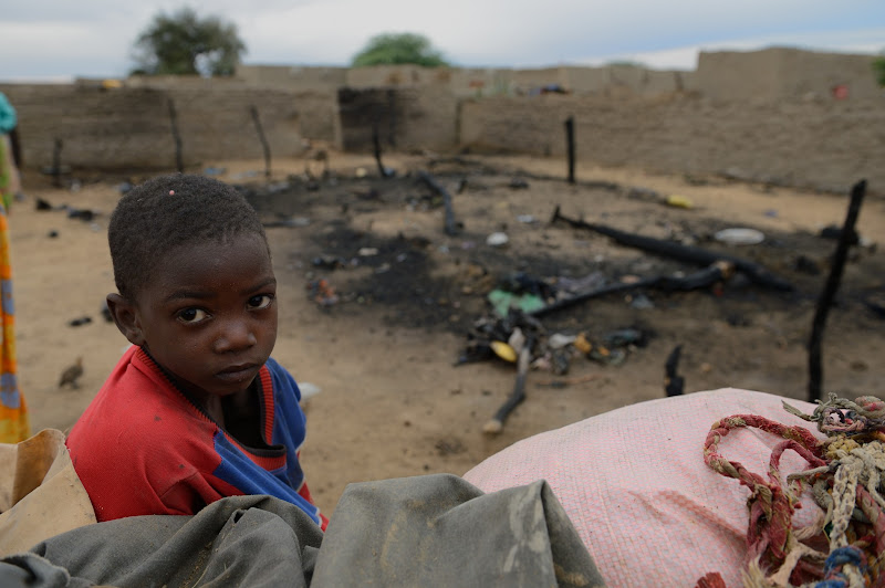 Photo: A child stand next to his house destroyed by a French airstrike on January 27, 2013 in Lere. French-led forces on Janaury 28, 2012 seized Mali's fabled desert city of Timbuktu in a lightning advance north as fleeing Islamists torched a building housing priceless ancient manuscripts. AFP/PHOTO ERIC FEFERBERG        (Photo credit should read ERIC FEFERBERG/AFP/Getty Images)