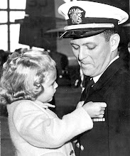 Photo: LT Glenn Kelley has 5 year old daughter pin his wings upon his designation of becoming an aviator