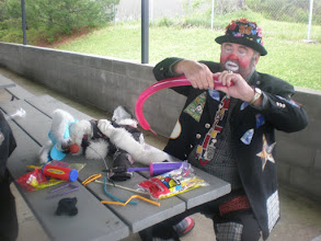 Photo: one of the clowns working on Kaleya's balloon