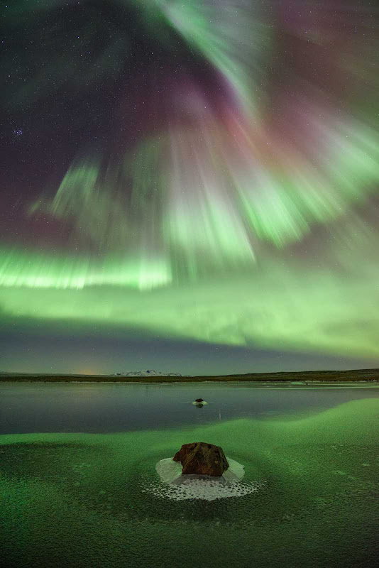 Cruise to Iceland to view the Northern Lights.