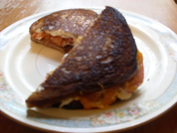 Cook both sides of sandwich until golden brown and cheese is melted. Remove from...