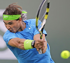 Photo: Rafael Nadal, of Spain, returns a shot to Marcel Granollers, of Spain, during a match at the BNP Paribas Open tennis tournament Tuesday, March 13, 2012, in Indian Wells, Calif. (AP Photo/Darron Cummings)䆴ā溠ܓ