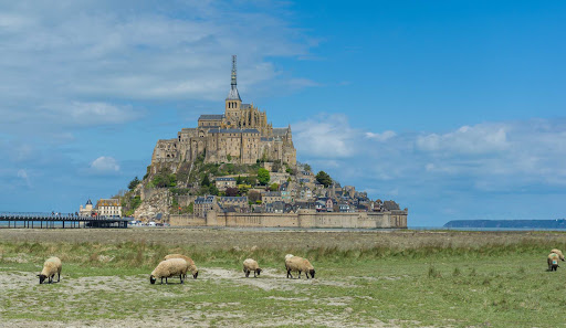 Explore the fortified island commune of Mont Saint Michel in Normandy, France.