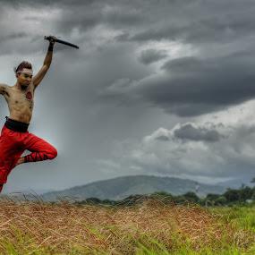 flying Aliguyon by Rajha Tahir - People Portraits of Men