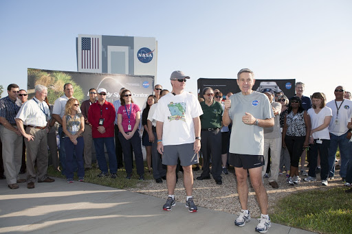 Florida State Surgeon General John Armstrong prepare to kick off National Employee Health and Fitness Month with the NASA Moves challenge.