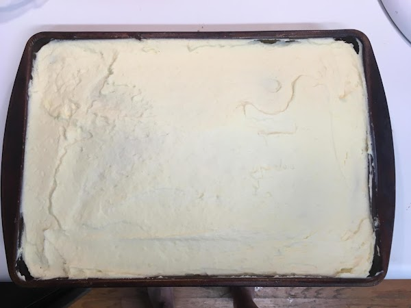 Once you have the frosting prepared, take a frosting spatula and spread it out...