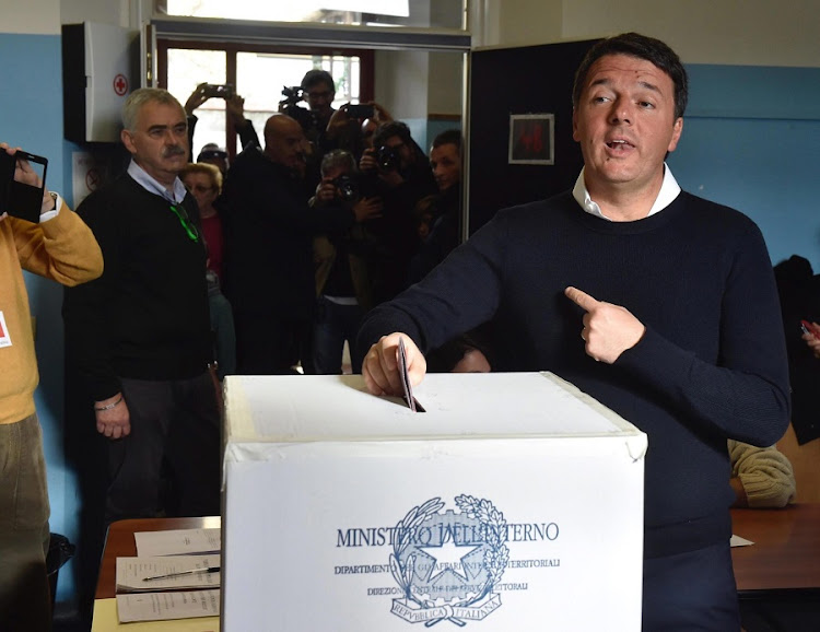 Italian Premier Matteo Renzi casts his ballot at a polling station near Florence, Italy, on Sunday. Picture: EPA/MAURIZIO DEGL' INNOCENTI