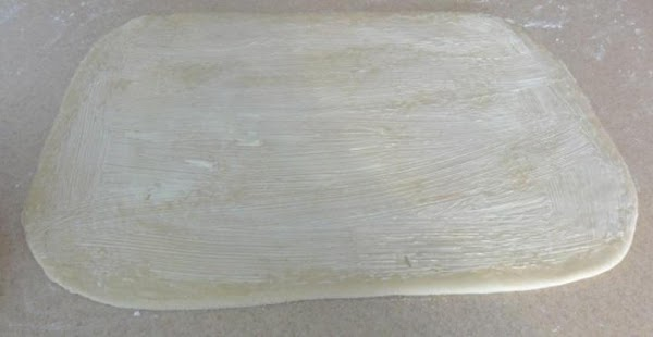 Spread half of the soften butter on the rolled out dough.