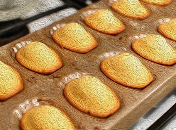Remove from oven, turn the pan over and give it a tap. The Madeleines...
