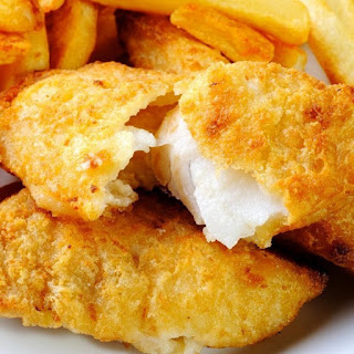 Fried Haddock with Potatoes and Onions.