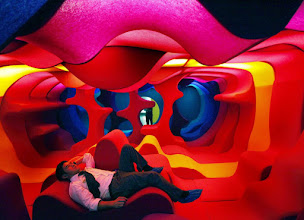 Photo: A museum visitor relaxes in a furniture installation titled ' Phantasy landscape' designed by designer and architect, Verner Panton of Denmark who's works are currently on display at the National Museum of Singapore, Monday June 8, 2009 in Singapore.(AP Photo/Wong Maye-E)