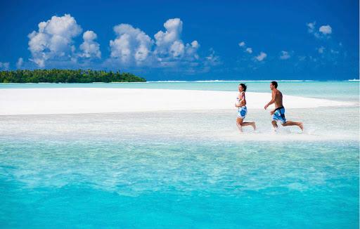 Running along Aitutaki Beach in the Cook Islands.
