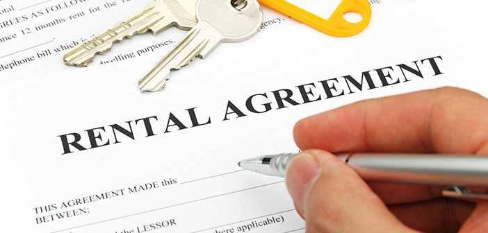 Eental Agreement Form With Signing Hand And Keys And Pen