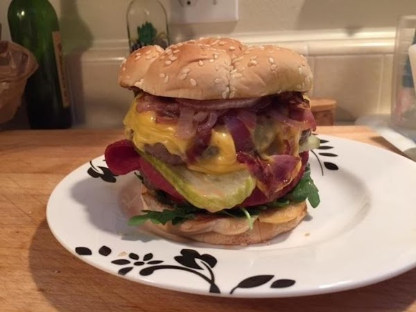 Assembling the sandwiches: Divide the arugula between the bun bottoms followed by a slice of...