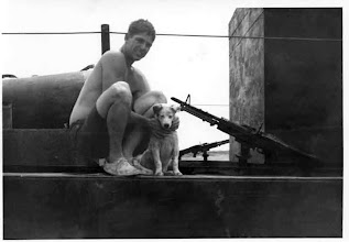 Photo: Harris just before he machined gun the dog.