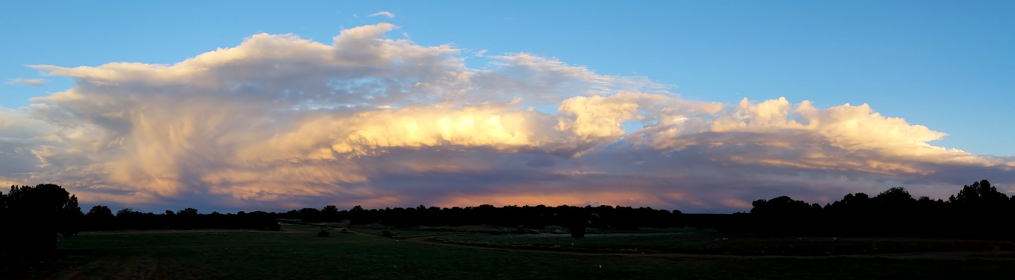 Photo: Passing storm clouds at sunset