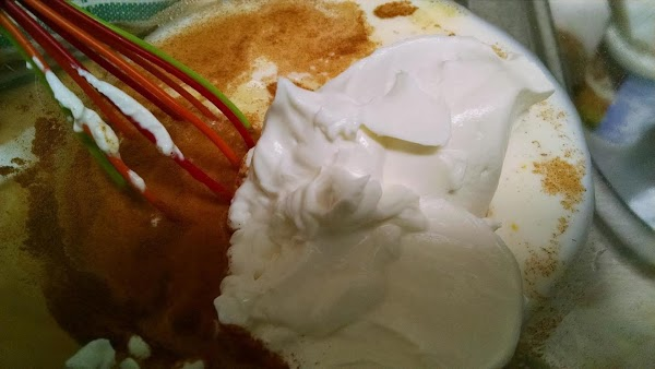 In a large bowl, combine the beaten egg, milk, sugar, cinnamon and sour cream....