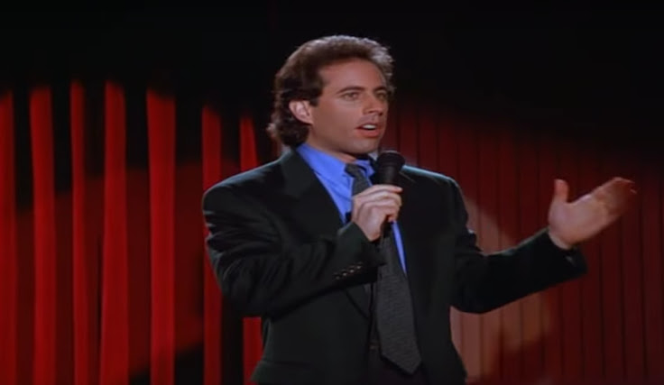 Seinfeld on stage at The Improv.