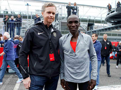 e985bf7b9614 Nike President and CEO Mark Parker poses for a picture with Eliud Kipchoge  after an attempt