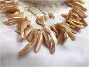 Photo: # 224 Mother of pearl, gold plate $120
