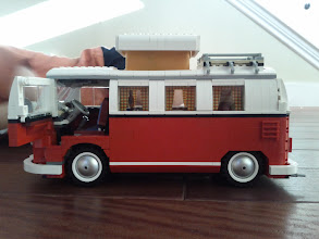 Photo: drivers side view with door open and popup camper