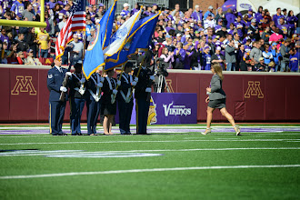 Photo: In the spirit of Breast Cancer Awareness Month, the Minnesota National Guard provided a Breast Cancer Survivor Military Color Guard to present the colors prior to the Minnesota Vikings game at the University of Minnesota Field on Oct. 12, 2014. Members of the Color Guard were Col. Sandy Best, Senior Master Sgt. Jami Panula, Master Sgt. Brenda Woods, Master Sergeant Mike Panula, Staff Sgt. Cassie Mecuk and Staff Sgt. Michael Mecuk.
