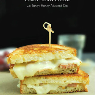 Grilled Ham and Cheese Sandwich with Tangy Honey Mustard Dip.