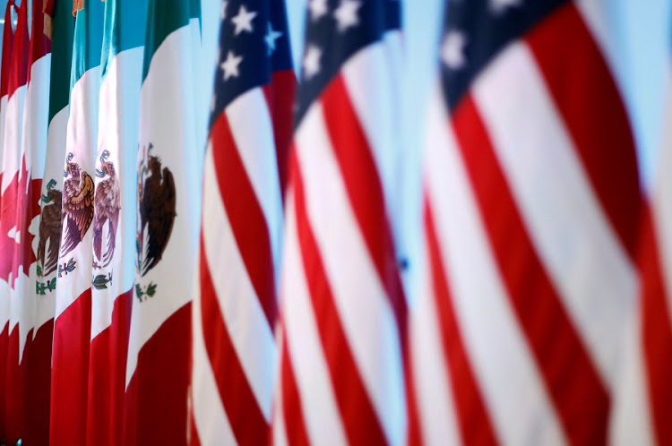 Flags of Canada, Mexico and the US are seen before a joint news conference on the closing of the seventh round of NAFTA talks in Mexico City, Mexico. Picture: REUTERS/EDGARD GARRIDO