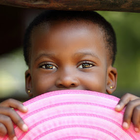 Bright eyes by Debbie Aird - Babies & Children Child Portraits ( child, looking, peeping, person, girl, african, bright, pink, young, people, eyes )