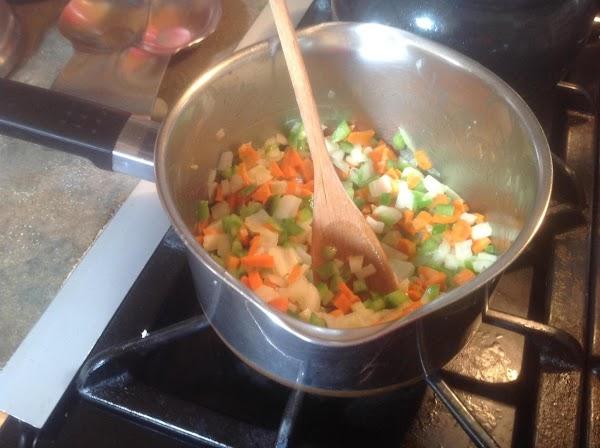 Melt butter in a medium sauce pan over medium high heat. Add the chopped...