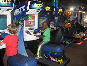 Photo: Next up: the Arcade. These kids are GOOD at racing games.