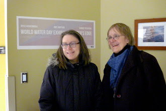Photo: Bonnie Peterson and Joyce Koskenmaki standing in front of Amy Arntson watercolors