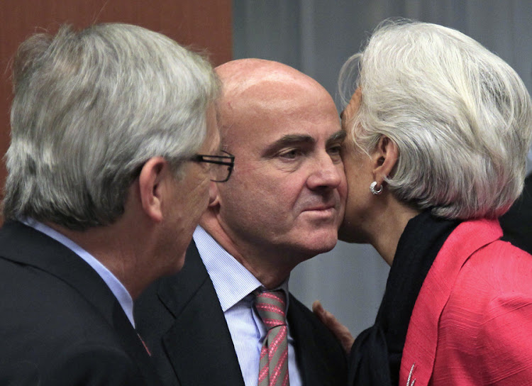 TOP LEVEL: Spanish Economy Minister Luis de Guindos (middle) is greeted by Eurogroup chairman Jean-Claude Juncker (left) and IMF chief Christine Lagarde at the Eurogroup meeting in Brussel. Picture: REUTERS