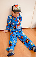 Photo: Then it was time to try on the pajamas. Once again, they were the perfect fit. They're cozy, warm, and big enough to fit him next winter too. The first thing we noticed about them was how incredibly soft they are. I totally wish they made them in my size. I'd wear them. I like Angry Birds...except for the level I can't beat.