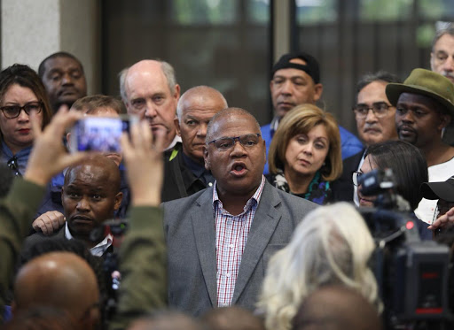 Cape Town mayor Dan Plato addresses refugees camped outside the UNHCR