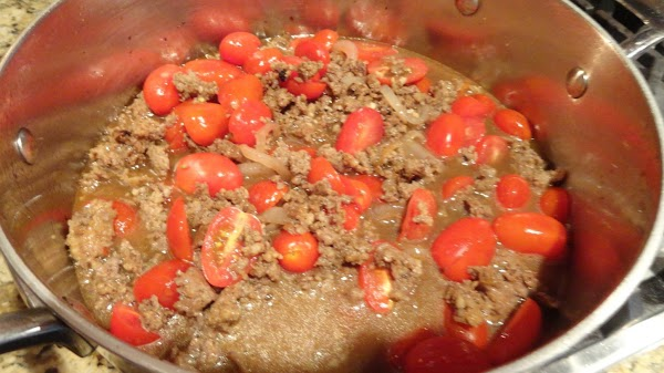 Add garlic, tomatoes, sausage, and vinegar. Add chicken stock and cook 30 mins. Mix...