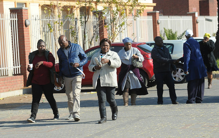 Rapodile family members outside the Magistrate court in Benoni.