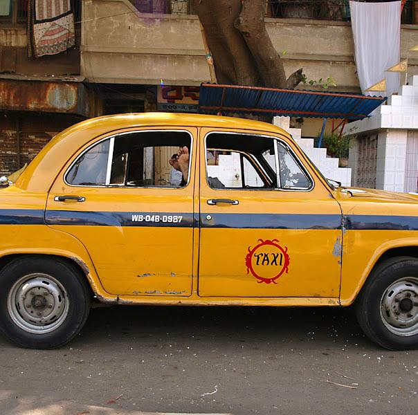 Photo: 5 Sleeping taxi driver, waiting for clients. Kolkata, India (c) Romain Philippon