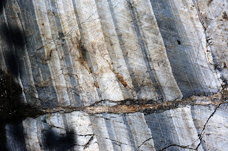 Photo: Note the layers have been offset over a foot at this fault in the outcrop.
