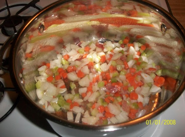 Saute bacon in large saucepan until crisp.  Add onion, carrots and celery; saute...